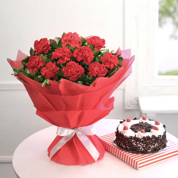 10 Red Carnations with Black Forest Cake (Eggless) (Half Kg)