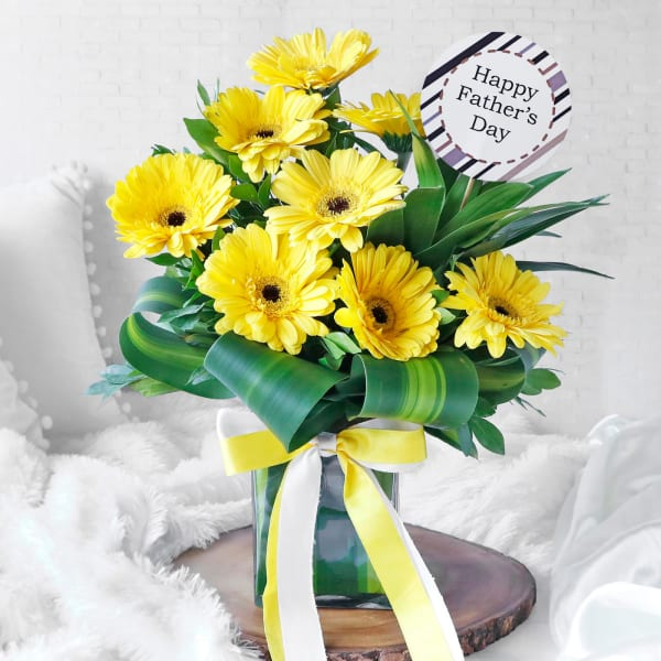 8 Yellow Gerberas in Square Vase for Father's Day