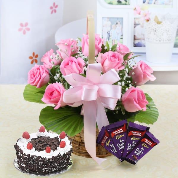 Basket of 10 Pink Roses with Half Kg Black Forest Cake & Dairy Milk