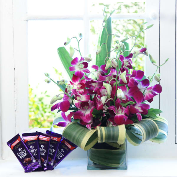 Beautiful 6 Purple Orchids in a Vase with Chocolate Bars