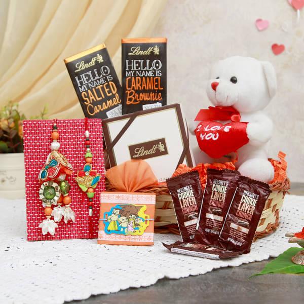 Beautiful Family Rakhi Set with Chocolate Hamper in a Gift Basket