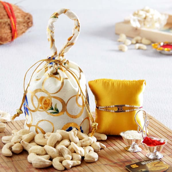Beautiful Om Rakhi with Cashews in Silk Potli