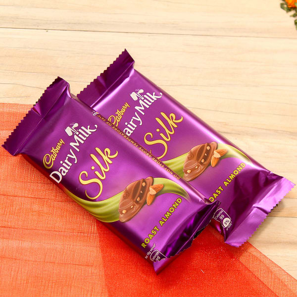 Beautiful Set Of Two Rakhi In Puja Thali And Dairy Milk Chocolates