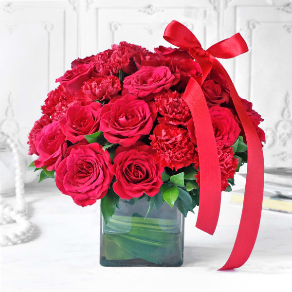 Bouquet of Red Carnations & Roses in Square Vase