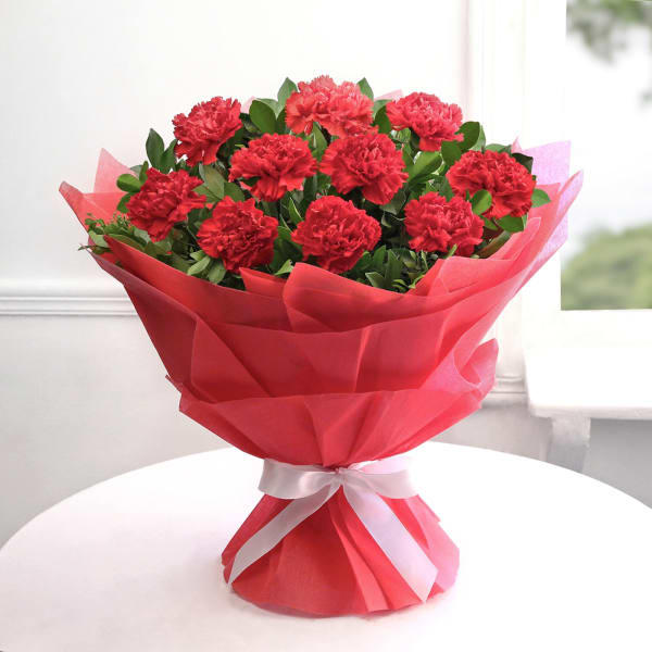 Bunch of 10 Red Carnations in Tissue Wrapping