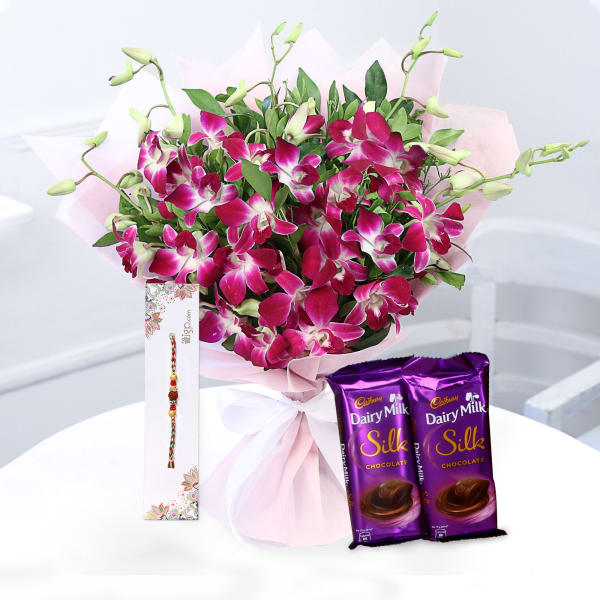 Bunch of 6 Orchids with Rakhi & Dairy Milk Silk Bars