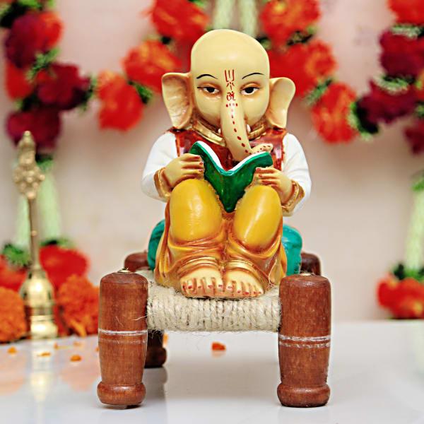 cute lord ganesha reading a book idol gift send home and living