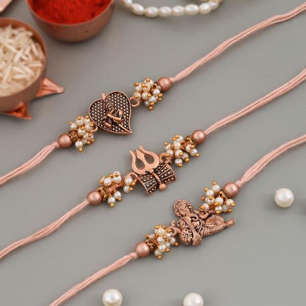 Divine Antique Pearl Rakhi (Set of 3)