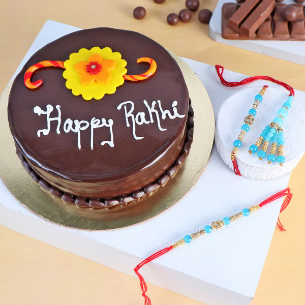 Family Rakhi Set Of 3 With Chocolate Truffle Cake (Half kg)