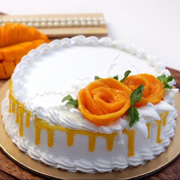 Fresh Mango Cream Cake (2 Kg ) with Flower Topping