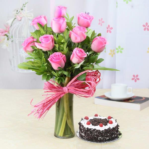 Glass Vase of 10 Pink Roses with Black Forest Cake (Half Kg)