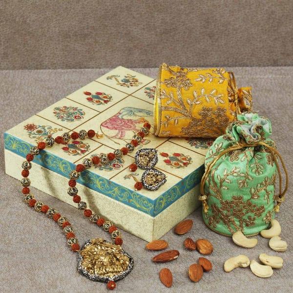 Hamper of Ethnic Jewellery & Cashew Potli in Designer Box