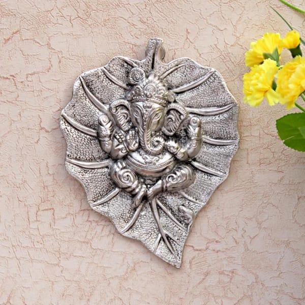Metal Ganesha Carved on a Leaf - Wall Hanging