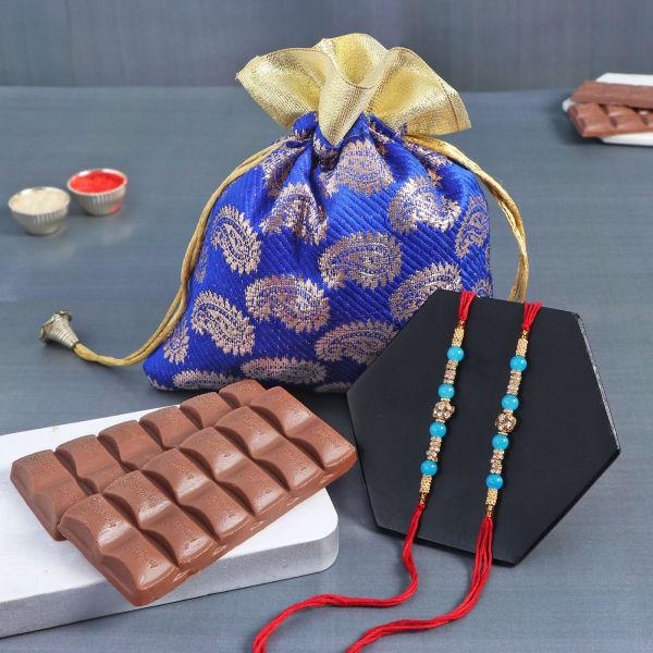 Pearl Rakhi Set Of 2 With Smooth Chocolates In Potli