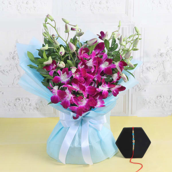 Pearl Rakhi With Bunch Of Orchids
