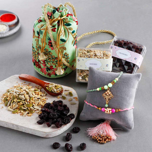 Pearl Rakhis With Healthy Snacks And Potli