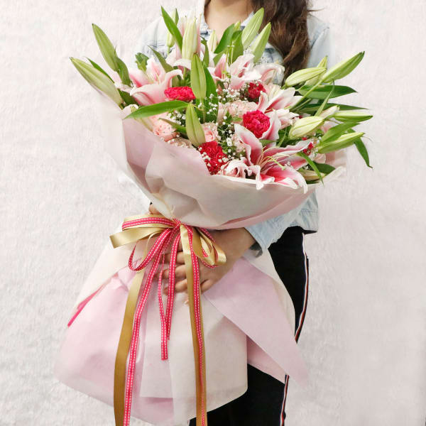 Pink Lily Roses & Carnations Arranged in a Ribbon Bouquet
