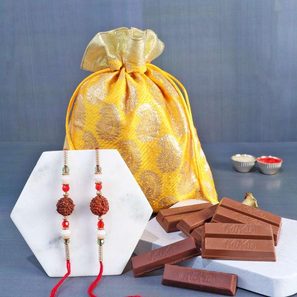 Rudraksh Rakhi Set Of 2 With Wafer Chocolates In Potli