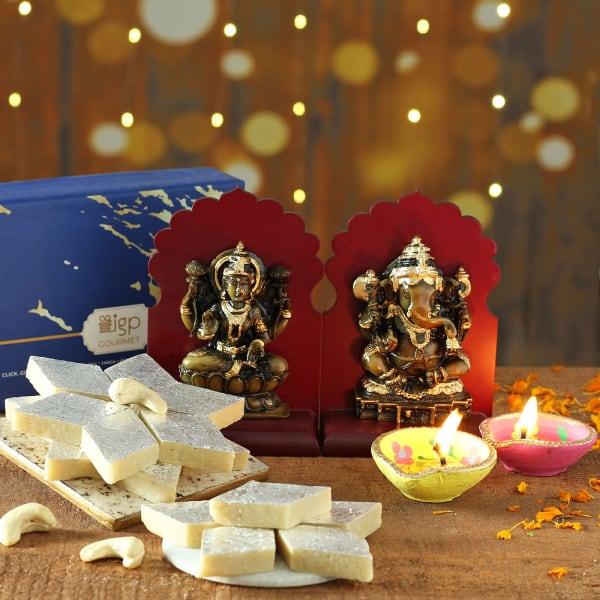 Set of 2 Clay Diya with Laxmi Ganesha Idols & Sweets