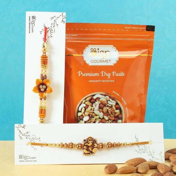 Set of 2 Flower & Ganesha Rakhi with Gourmet Gift by IGP