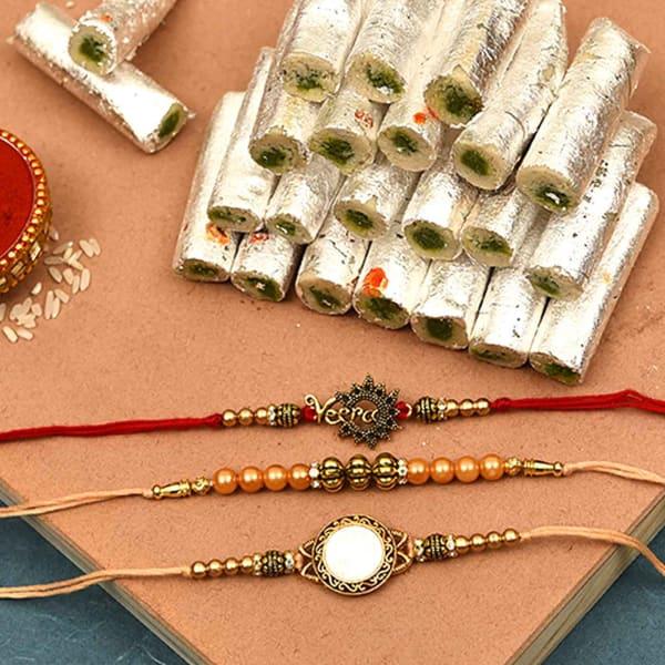 Set of 3 Antique Metallic Rakhi with Kaju Pista Roll