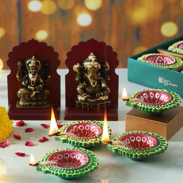 Set of 4 Clay Diya with Maa Laxmi & Lord Ganesha Idols