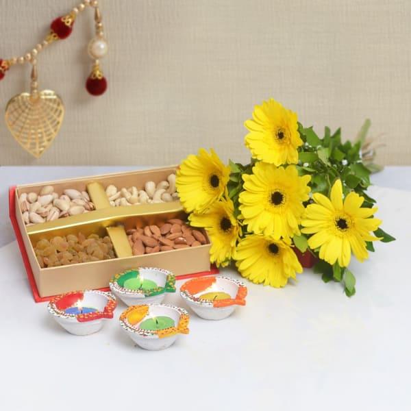 Six Yellow Gerberas With Assorted Dryfruits 400 Gms & Earthen Diyas