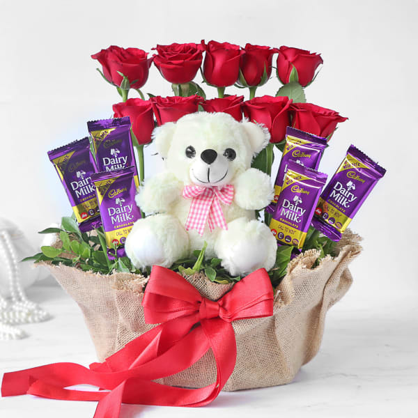 Stylish Arrangement of 10 Red Roses with Dairy Milk & Teddy