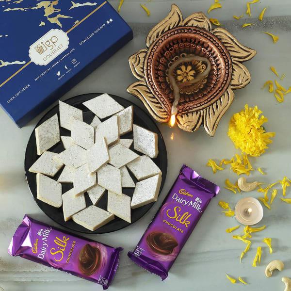 Swastik Clay Diya with Dairy Milk Silk Bars & Kaju Katli (500 gms)