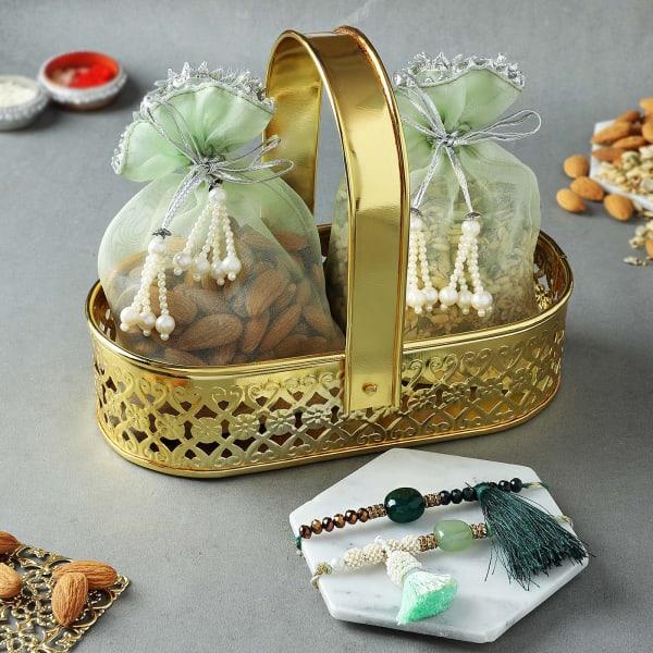 Tassel Rakhi Set Of 2 With Healthy Goodies In Basket
