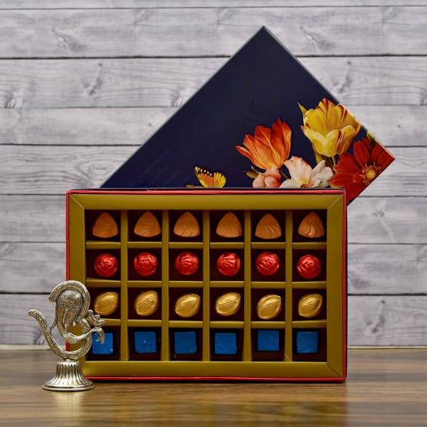 White Metal Om Ganesha Showpiece with Assorted Chocolate Box