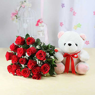 18 RED ROSES AND TEDDY BEAR