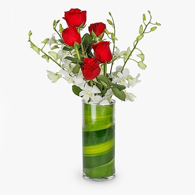 6 RED ROSES AND WHITE ORCHIDS IN A VASE