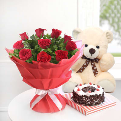 A Bunch Of 10 Red Roses With Half Kg Black Forest Cake And Teddy Bear