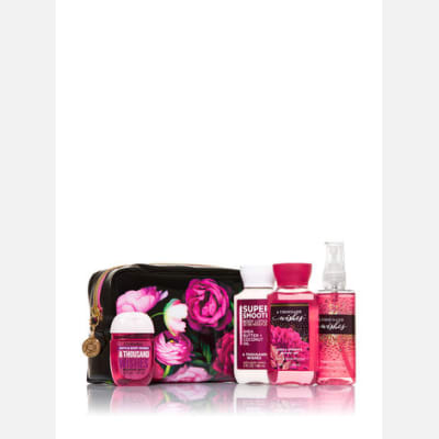 A Complete Bath Set In Floral Cosmetic Bag