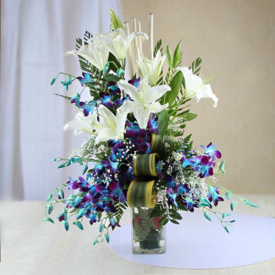 A Vase of White Lilies and Blue Orchids