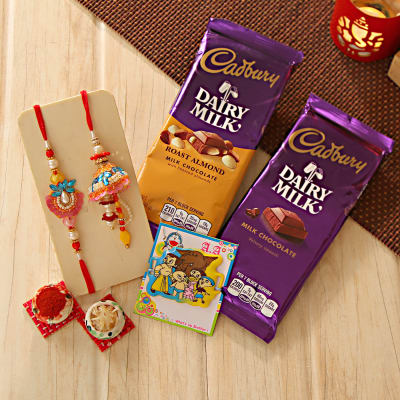 Send gifts to usa online gifts delivery in usa online us gift adorable bhaiya bhabhi and kids rakhi with assorted cadbury chocolates negle Gallery