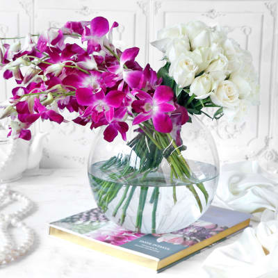 Assorted Flowers in Globe Vase (33 Stems)