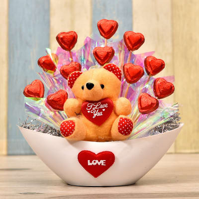 Assorted Heart Shape Chocolates Bouquet with Teddy in Boat Shaped Bowl