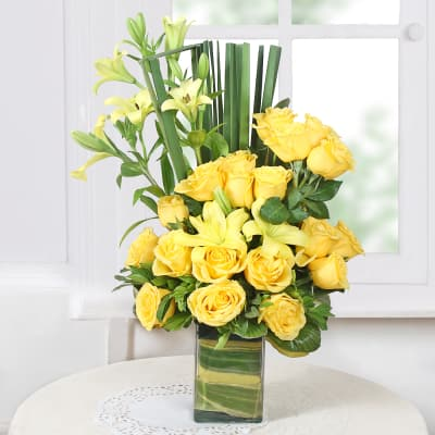 Assorted Yellow Flowers in a Vase
