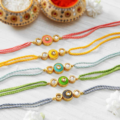 Send gifts to new zealand online flowers cakes delivery in new beautiful kundan set of 5 rakhi negle Images