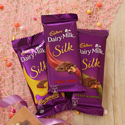 Beautiful Set Of 2 Rakhis With Assorted Cadbury Chocolate Bars Gift