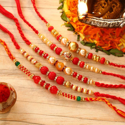 Send gifts to usa online gifts delivery in usa online us gift beautiful set of 5 bead stone work rakhi negle Gallery
