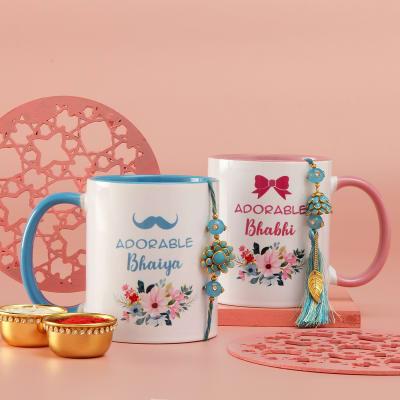Blue Pachhi Work Bhaiya Bhabhi Rakhis with Personalized Pink And Blue Handle Mug Set