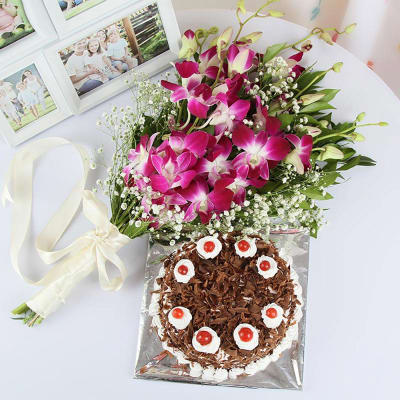 b6f8d2ef24f Bouquet of 6 Orchids with Black Forest Cake (Half Kg)