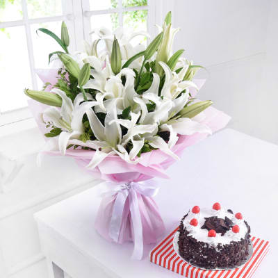 Bouquet of 6 White Lilies with Black Forest Cake (Eggless) (Half Kg)