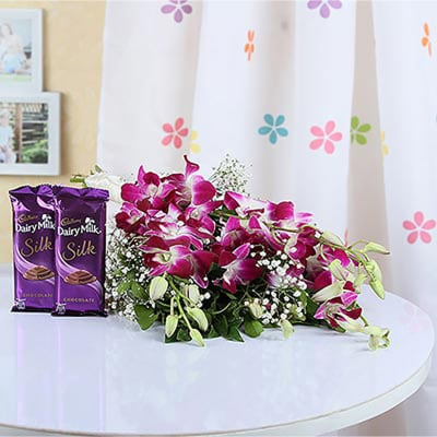 BOUQUET OF PURPLE COLOR ORCHIDS AND 2 CADBURY SILK CHOCOLATES