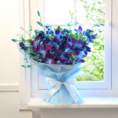 Bunch Of 10 Blue Orchids In Tissue Wrapping