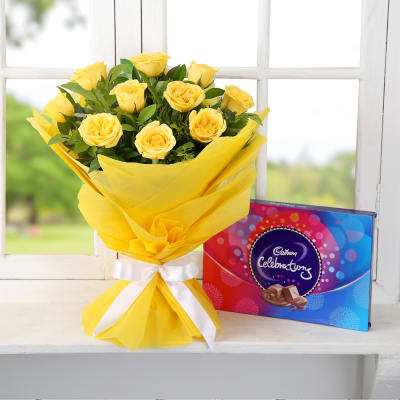 Bunch Of 10 Yellow Roses Wrapped In Tissue With Cadbury Celebrations