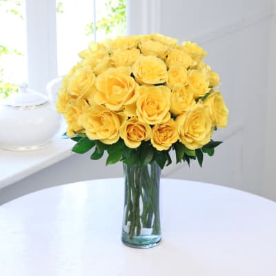 Buy yellow flowers online order yellow color flowers for delivery bunch of 25 yellow roses in a glass vase mightylinksfo